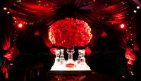 red entryway with large red roses floral arrangement